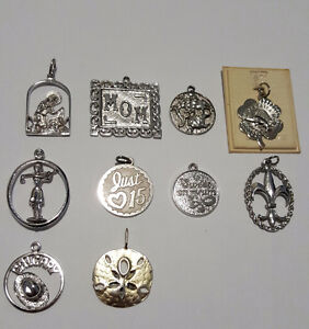 COLLECTION OF 10 SILVER CHARMS