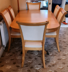 Extendable wood dining table and 6 chairs.