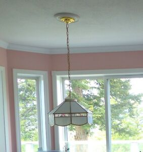 Beautiful light fixture to hang over your kitchen or dining room