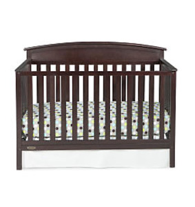 Crib with bedding and mattress