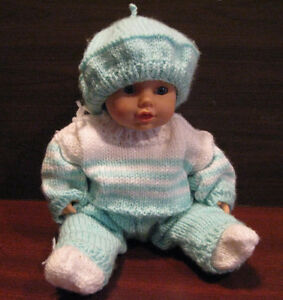 Doll with hand knitted outfit