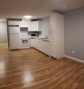 OWN LAUNDRY-UTILITIES INCL-NEW INFILL-1 BED +DEN LEGAL BSMT!