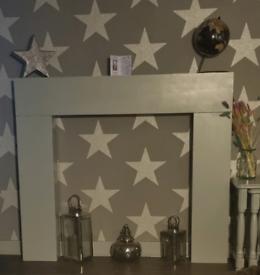 Fire surround, lightweight painted grey