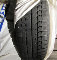 Michelin X-ice 235/70R16 tires set on rims