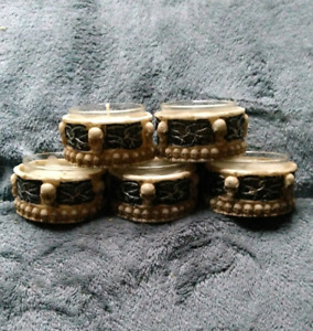 5 skull tealight holders candles included