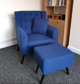Blue accent chair and footstool.