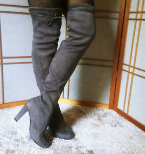 Thigh high boots,Stylish and elegant, size 7