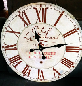 Beautiful, antique looking, wall mounted clock.