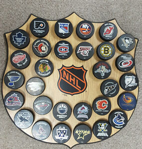 Officially Licensed NHL Puck Wall Plaque