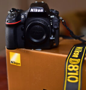 Nikon D810 with 5164 shutter actuations.  Mint