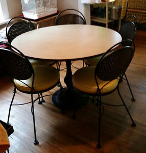 Cast iron table and iron chairs