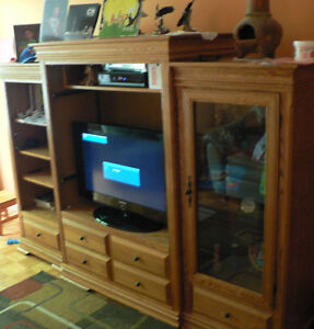 """Entertainment unit with a 32"""" TV"""