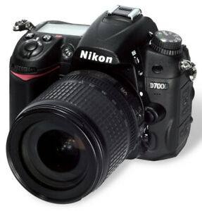 D7000 with 18-200mm lens.