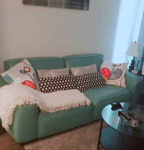 Large two seater Turquoise leather couch.