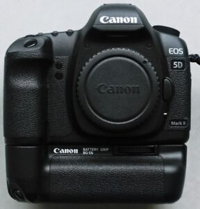 Canon 5D Mark II Body and grip and two batteries.