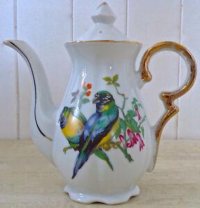 Antiquité. Collection. Magnfique petite théière en porcelaine