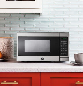 Brand New GE Microwave - Small Stainless Steel 0.7 CF