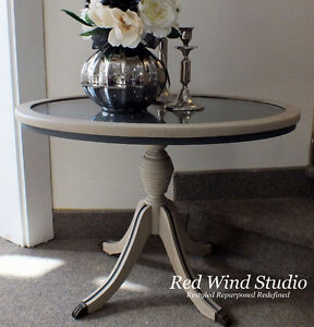 Oval Glass Top Table by Red Wind Studio