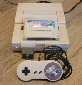 Super Nintendo console w/cables, controller and cartridge