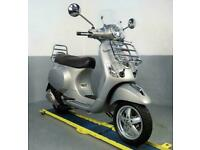 2014 Piaggio Vespa LX 125 3v Touring SE with just 2k miles racks and screen