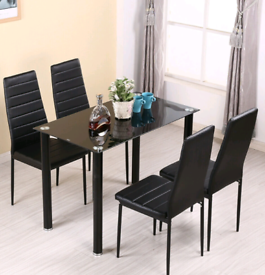 Brand new in box dining table and 4 chairs