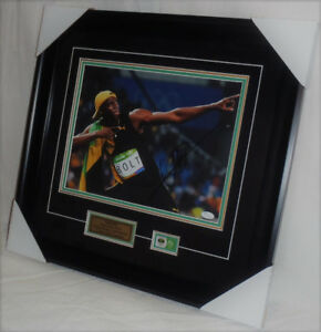 "Usian Bolt ""Worlds Fastest Man"" Signed & Framed 11x14 w/ COA"