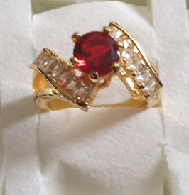 Brand new 24 k gold plated ladies ring, size 7