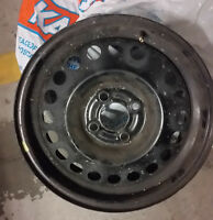 Set of 15 in steel rims and rim covers for sale