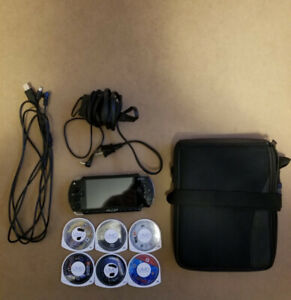 PSP w/charger, Computer Connector,5 Games 1 Movie & CarryingCase