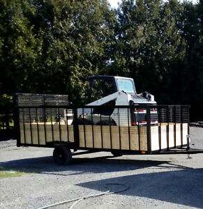 Large utility trailer with ramps