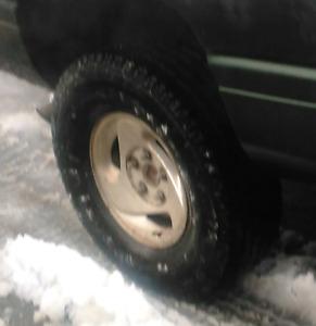 "Dodge 1500 stock progressive rim, 16"" on mount"