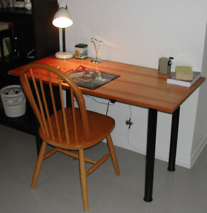 Worktable with removable legs with chair and lamp.