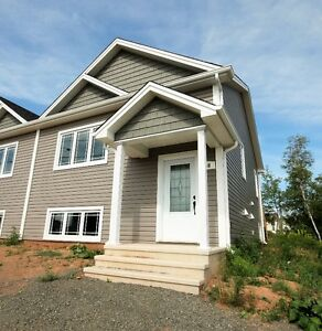 New semi with heatpump and fireplace! A Must see!!