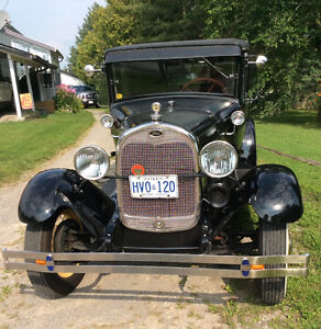 1928 Model A Ford 4 Door Leather Back
