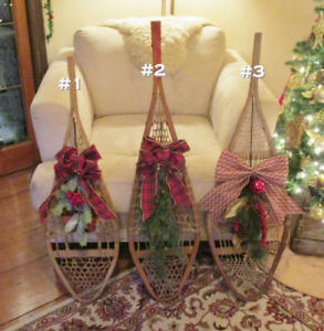 6 Different antique snowshoes decorated for Christmas