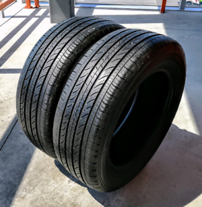 Set of two 215/60/16 Michelin all season tires. 7/32nd tread