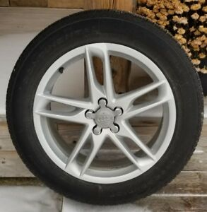 Like new, Audi OEM Alloy rims with All-season tires