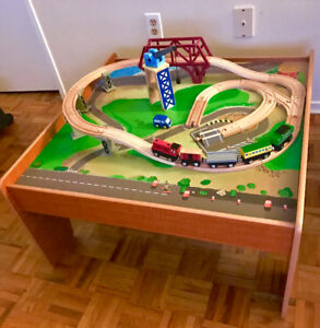 Train table and train set with 5 trains and 1 car