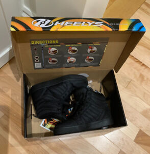 Heely's Brand new in box, youth size US 2