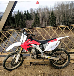 06 CRF250R. (NEED GONE ASAP)