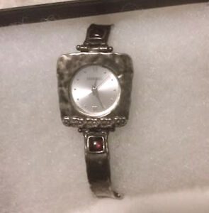 Silver watch with two garnets