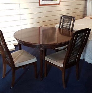 Solid wood dining room set with folding leaf