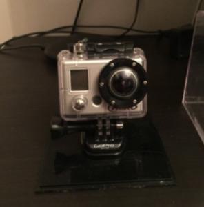 GO Pro Hero Silver( First Gen) w/brand new sealed extra battery