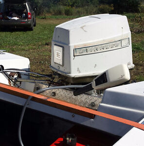 1970 Evinrude 65HP outboard with extras