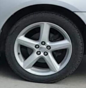 """17"""", 5x100 Bolt pattern Toyota factory rims with tires."""