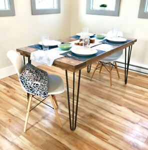 Salvaged wood dining table with hairpin legs