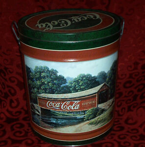 "Large Coca Cola Tin 14"" tall x 12 1/4"" in dia. 1997"