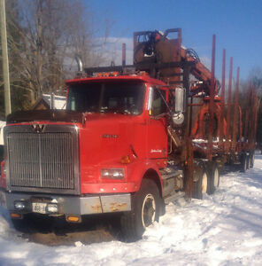 Western Star log truck with Timmins log trailer and picker