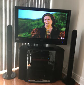 HD 1080 42 inch Hitachi tv, stand and surround sound speakers