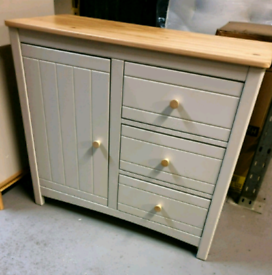 A new stylish light grey x pine 1 door 3 drawer sideboard.